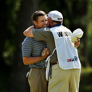 Michael Weaver gets a hug from his father/caddie Bill after defeating Justin Thomas during the semifinals of the 112th U. S. Amateur Championship at Cherry Hills Country Club in Cherry Hills Village, Colo.