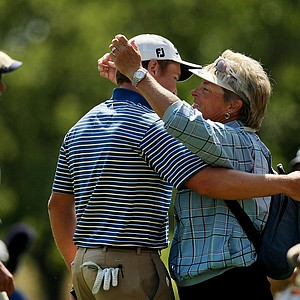 Michael Weaver hugs his swing instructor/coach Cindy Vining after defeating Justin Thomas during the semifinals of the 112th U. S. Amateur Championship at Cherry Hills Country Club in Cherry Hills Village, Colo.