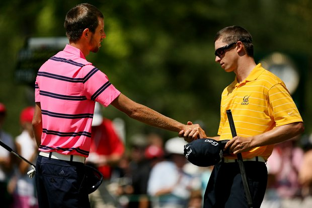 Brandon Hagy shakes hands with Steven Fox after Hagy lost to Fox during the semifinals of the 112th U. S. Amateur Championship at Cherry Hills Country Club in Cherry Hills Village, Colo.