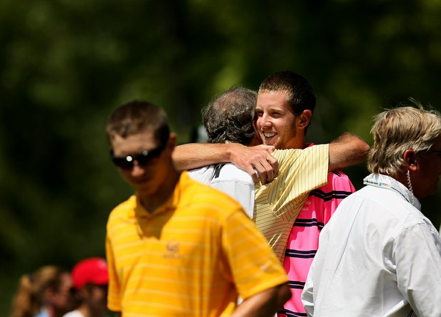 Steven Fox hugs his father/caddie Alan Fox after defeating Brandon Hagy during the semifinals of the 112th U. S. Amateur Championship at Cherry Hills Country Club in Cherry Hills Village, Colo.