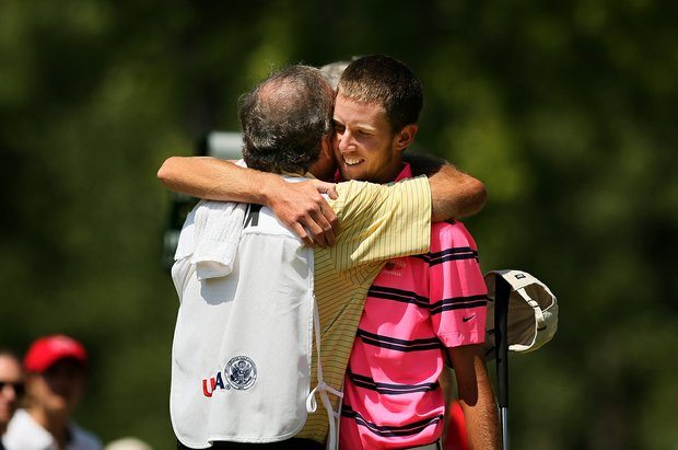 Steven Fox gets a hug from his father/caddie Alan Fox after defeating Brandon Hagy during the semifinals of the 112th U. S. Amateur Championship at Cherry Hills Country Club in Cherry Hills Village, Colo. Fox will face Michael Weaver in the finals.