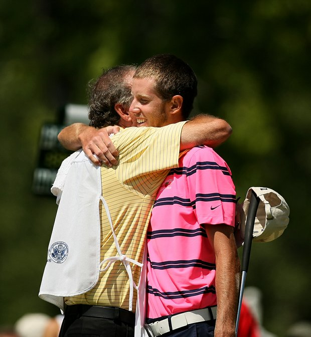 Steven Fox gets a hug from his dad/caddie after they defeated Brandon Hagy to reach the finals of the 112th U. S. Amateur Championship at Cherry Hills Country Club in Cherry Hills Village, Colo. Fox will face Michael Weaver in the final.