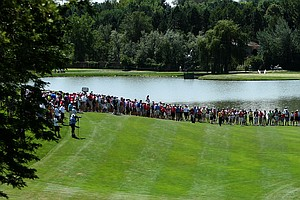 Spectators line the fairway at No. 18 to watch as Brandon Hagy hits his second shot during the semifinals of the 112th U. S. Amateur Championship at Cherry Hills Country Club in Cherry Hills Village, Colo.