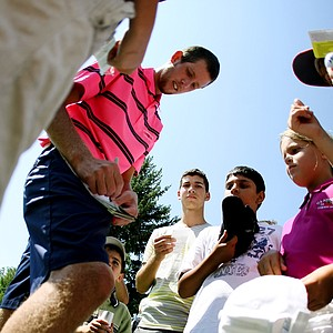 Steven Fox signs autographs after winning his match during the semifinals of the 112th U. S. Amateur Championship at Cherry Hills Country Club in Cherry Hills Village, Colo.