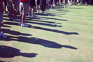 Long shadows from spectators during the semifinals of the 112th U. S. Amateur Championship at Cherry Hills Country Club in Cherry Hills Village, Colo.