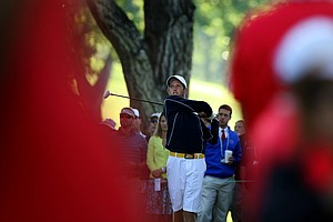 Steven Fox is framed by the spectators as he tees of during the morning round of final of the 112th U. S. Amateur Championship at Cherry Hills Country Club in Cherry Hills Village, Colo.