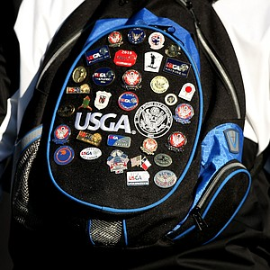 A volunteer's backpack during the final of the 112th U. S. Amateur Championship at Cherry Hills Country Club in Cherry Hills Village, Colo.