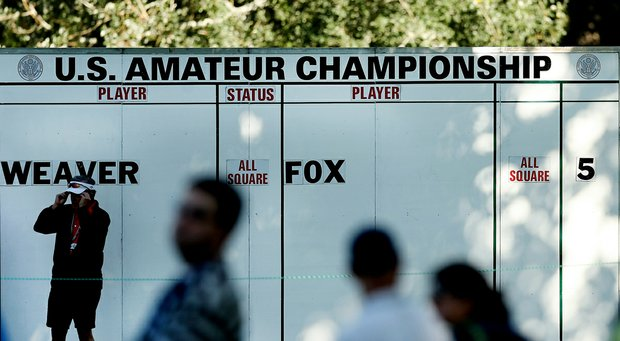 An on course leaderboard during the morning round of the final of the 112th U. S. Amateur Championship at Cherry Hills Country Club in Cherry Hills Village, Colo.