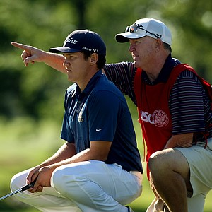 Michael Weaver of Fresno, CA,  gets a little help from his dad/caddie, Bill, during the final of the 112th U. S. Amateur Championship at Cherry Hills Country Club in Cherry Hills Village, Colo. Weaver attends University of California-Berkley.