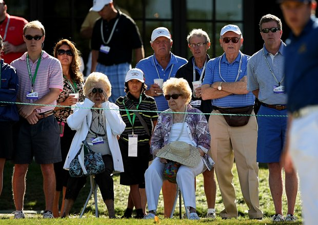 Patrons watch Michael Weaver's putt at No. 9 in the morning round of  the final of the 112th U. S. Amateur Championship at Cherry Hills Country Club in Cherry Hills Village, Colo.