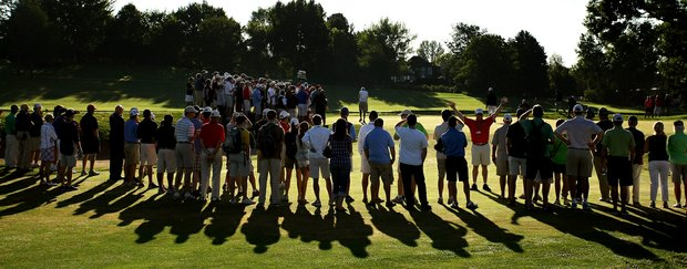 Crowds line up to watch at the second green during the morning round of the final of the 112th U. S. Amateur Championship at Cherry Hills Country Club in Cherry Hills Village, Colo.