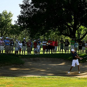 Steven Fox hits out of the bunker at No. 8 during the morning round of the final of the 112th U. S. Amateur Championship at Cherry Hills Country Club in Cherry Hills Village, Colo.