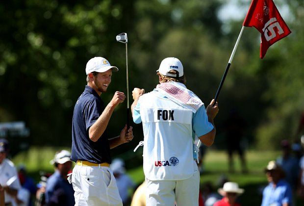 Steven Fox celebrates with his caddie at No. 15 during the second round of the final of the 112th U. S. Amateur Championship at Cherry Hills Country Club in Cherry Hills Village, Colo.