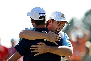 Steven Fox celebrates with his caddie, Ben Rickett, during the final of the 112th U. S. Amateur Championship at Cherry Hills Country Club in Cherry Hills Village, Colo. Rickett caddied for him during the second 18 of the championship.