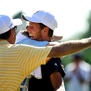 Steven Fox celebrates with his caddie, Ben Rickett and father Alan during the final of the 112th U. S. Amateur Championship at Cherry Hills Country Club in Cherry Hills Village, Colo. His father also caddied during the final match.--(Photo by Tracy Wilcox/GOLFWEEK)