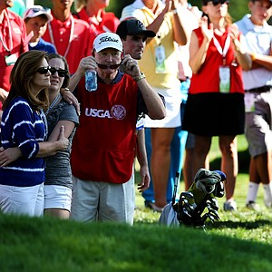 Michael Weaver along with his family,left, mom, Joanne, sister, Lauren and dad Bill, sit dejected near the green at No. 1, as Steven Fox celebrates during the final of the 112th U. S. Amateur Championship at Cherry Hills Country Club in Cherry Hills Village, Colo.