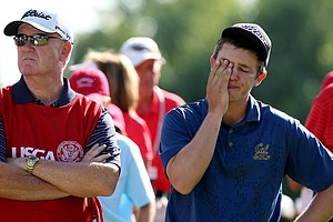 Michael Weaver lost to Steven Fox on the 37th hole after having the lead for most of the championship during the final of the 112th U. S. Amateur Championship at Cherry Hills Country Club in Cherry Hills Village, Colo. At left is his caddie/father Bill.