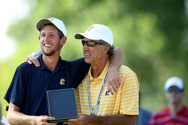 Steven Fox and his dad Alan share a moment after he was presented a gold medal for winning the 112th U. S. Amateur Championship at Cherry Hills Country Club in Cherry Hills Village, Colo.