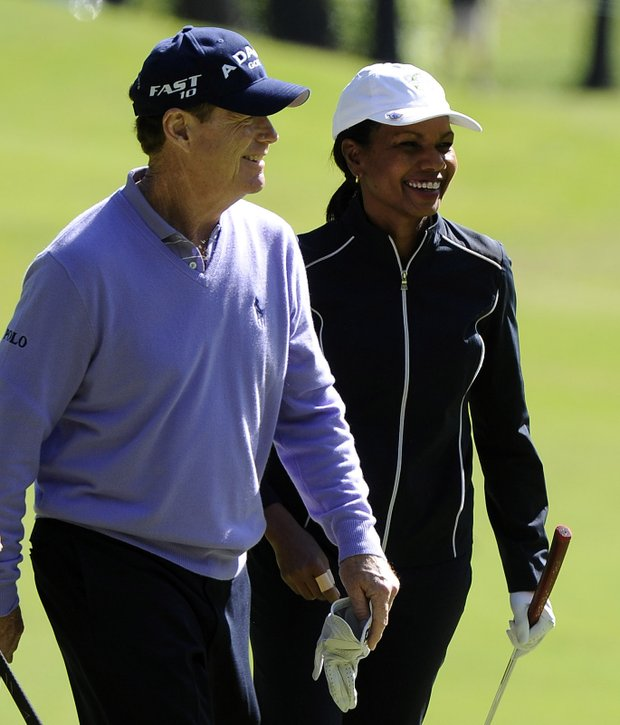 Tom Watson (left) and Dr. Condoleezza Rice (right) exit from the first green during the Regions Tradition NCR Pro-AM at Shoal Creek on May 4, 2011 in Birmingham, Alabama.