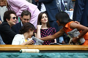 Tennis player Billie Jean King, actor Adam Shulman, actress Anne Hathaway and Condoleezza Rice attend the Ladies' final round match between Maria Sharapova of Russia and Petra Kvitova of the Czech Republic at the Wimbledon Lawn Tennis Championships at the All England Lawn Tennis and Croquet Club on July 2, 2011 in London, England.