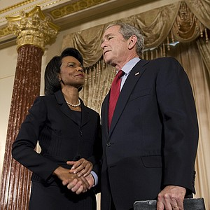 US President George W. Bush (R) shakes hands with US Secretary of State Condoleezza Rice (L) during a ceremony at the US State Department in Washington, DC, January 15, 2009.