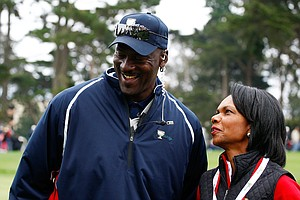 Condoleezza Rice waits alongside Team USA assistant Michael Jordan on the fifth hole during the Day Three Afternoon Fourball Matches of The Presidents Cup at Harding Park Golf Course on October 10, 2009 in San Francisco, California.