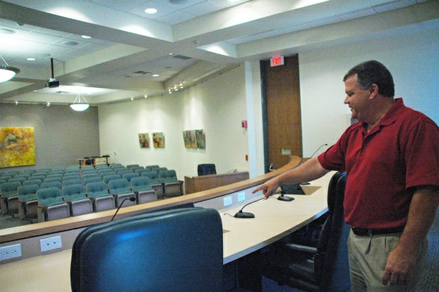 Winter Park City Manager Randy Knight shows some new screens up on the City Commission dais in the renovated City Hall, which will officially reopen Aug. 27.