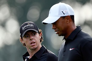 Rory McIlroy and Tiger Woods talk as they walk down the 10th hole during the First Round of The Barclays.
