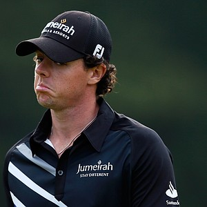 Rory McIlroy reacts after he missed a birdie putt attempt on the 10th hole during the First Round of The Barclays.