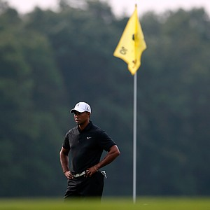 Tiger Woods looks on from the 10th hole green during the First Round of The Barclays on the Black Course at Bethpage State Park August 23, 2012.