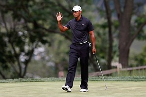 Tiger Woods waves after he made a birdie putt on the 14th hole during the First Round of The Barclays on the Black Course at Bethpage State Park.