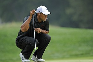 Tiger Woods lines up a putt on the 14th green during the first round of The Barclays at Bethpage Black Course on August 23, 2012 in Farmingdale, New York.
