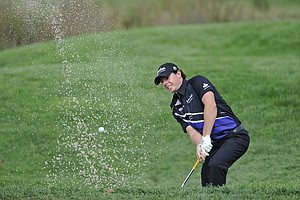 Rory McIlroy hits from a bunker on the 16th hole during the first round of The Barclays at Bethpage Black Course.