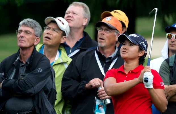 Yani Tseng watches as her second shot hits a tree and lands in the rough on the first hole during the first round of the LPGA Tour's Canadian Women's Open.