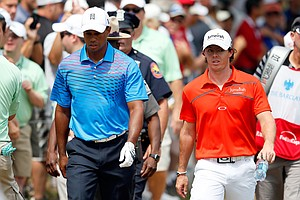 Tiger Woods and Rory McIlroy walk up the fairway on the third hole during the second round of The Barclays.