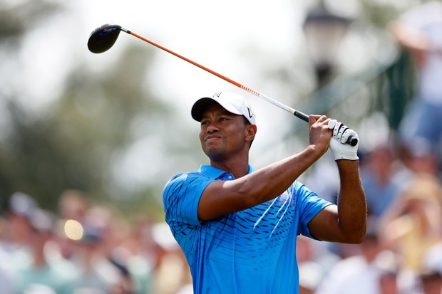 Tiger Woods watches his tee shot on the first hole during the second round of The Barclays at the Black Course at Bethpage State Park August 24, 2012.