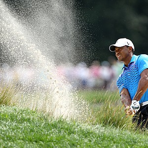 Tiger Woods hits a shot out of the bunker on the second hole during the second round of The Barclays at the Black Course at Bethpage State Park August 24, 2012.