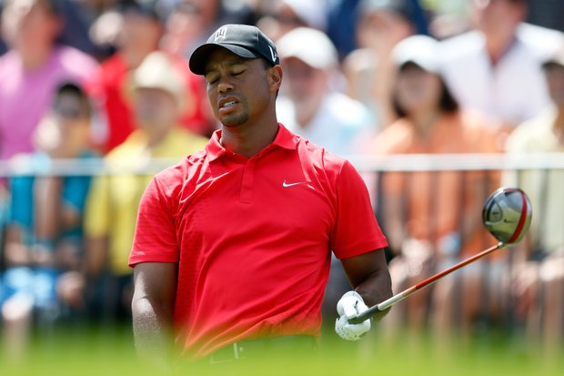 Tiger Woods reacts after he hit his tee shot on the first hole during the final round of The Barclays at the Black Course at Bethpage State Park.