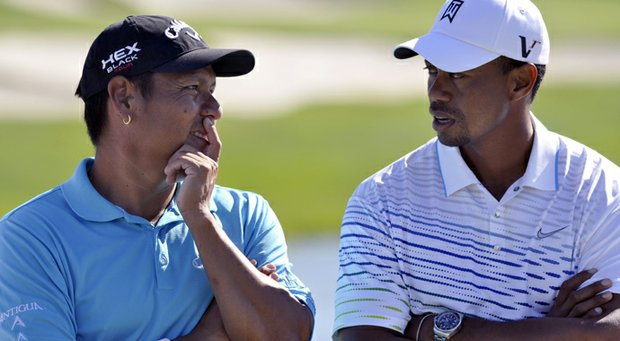 Notah Begay III, left, and Tiger Woods talk after winning the fifth annual Notah Begay III Foundation Challenge at Atunyote Golf Club at Turning Stone Resort and Casino in Verona, N.Y.