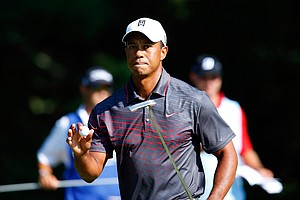 Tiger Woods reacts after making a putt for par on the 12th green during the first round of the Deutsche Bank Championship at TPC Boston.