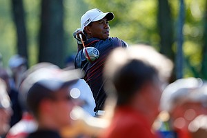 Tiger Woods tees off on the 12th hole during the first round of the Deutsche Bank Championship.