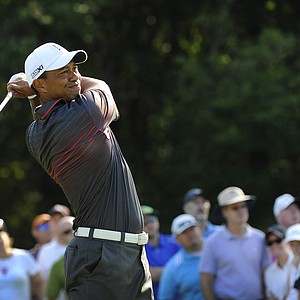 Tiger Woods hits a drive on the 14th hole during the first round of the Deutsche Bank Championship at TPC Boston.