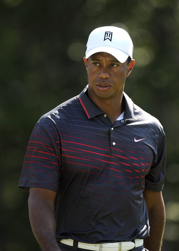 Tiger Woods exits from the 17th tee box during the first round of the Deutsche Bank Championship at TPC Boston.