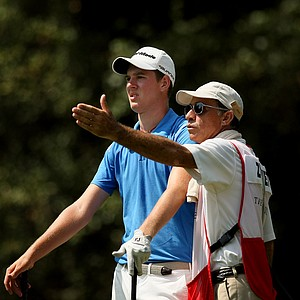 Federico Zucchetti of Italy gets some advice at No. 8 from his caddie during the final round of the TPC Junior Players at TPC Sawgrass The Players Stadium.
