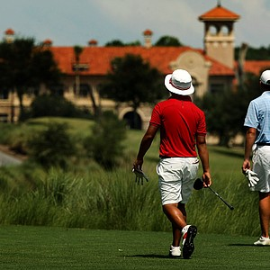 Jim Liu, left, and Robby Shelton IV walk up No. 9 during the final round of the TPC Junior Players at TPC Sawgrass The Players Stadium.