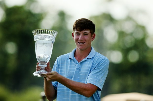 Robby Shelton IV poses with his trophy after winning the TPC Junior Players at TPC Sawgrass The Players Stadium. Shelton won by a shot over Brad Dalke.