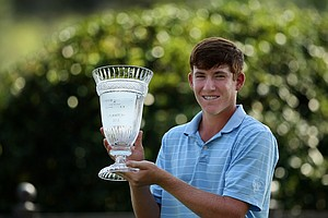 Robby Shelton IV poses with his trophy after winning the TPC Junior Players at TPC Sawgrass The Players Stadium. Shelton won by a stroke over Brad Dalke.