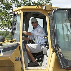 Unlike many architects, Gil Hanse likes to work on the bulldozer shaping greens.