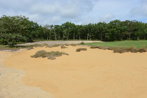 A view from the new par-3 4th green back to the tee. The new bunker gives the hole a Pine Valley feel.