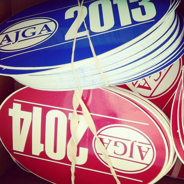 AJGA stickers at the first tee during the final round of the TPC Junior Players at TPC Sawgrass The Players Stadium.